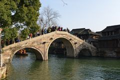 The historical Stone Bridge in Wuzhen town, Zhejiang, China. Wuzhen, a 1300-year-old water town on the lower reaches of the Yangtze River, is a national 5A stock photography
