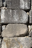 Historical stone wall texture. Background Stock Image