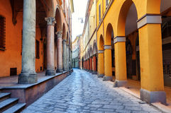 Historical street in Bologna, Italy. Historical arcade street in the old town of Bologna, Italy Stock Photo