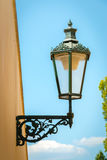 Historical street lamp on wall, Prague Stock Images