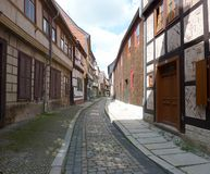 Historical street in Quedlinburg. A narrow winding lane paved with ancient cobble-stone in the medieval city of Quedlinburg. which is now one of the UNESCO's royalty free stock images