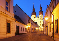 Historical street in Trnava with Saint Nicolas chu Stock Photo