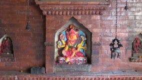 Historical temple wall with hindu gods in Katmandu stock footage