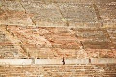 Historical theater and tourist walking around the ancient landmark in Ephesus Stock Photo