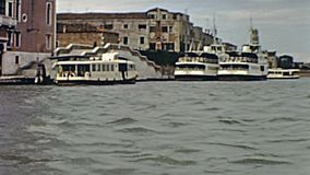 Venice water taxi. Historical touristic water taxi and water bus from Venezia to Murano island in venetian lagoon. Amateur archive footage on 1967s stock footage