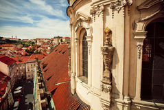 Historical tower of Baroque church building with sculptures and red tiled roof Royalty Free Stock Image