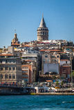 Historical tower and mosque in centre istanbul seashore with boats and tower turkey Royalty Free Stock Image