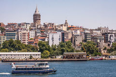 Historical tower and mosque in centre istanbul seashore with boats and tower turkey Royalty Free Stock Photos