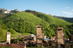 Historical towers and huts in mountain village. Royalty Free Stock Photos