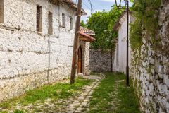 Historical town Berat, ottoman architecture in Albania, Unesco World Heritage Site. Berat, Albania- 30 June 2014: Narrow, cobbled streets in the historical town royalty free stock image