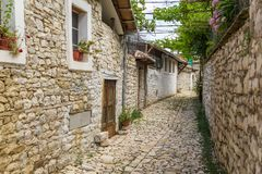 Historical town Berat, ottoman architecture in Albania, Unesco World Heritage Site. Berat, Albania- 30 June 2014: Narrow, cobbled streets in the historical town royalty free stock photography