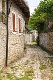 Historical town Berat, ottoman architecture in Albania, Unesco World Heritage Site. Berat, Albania- 30 June 2014: Narrow, cobbled streets in the historical town stock photography