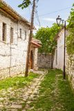 Historical town Berat, ottoman architecture in Albania, Unesco World Heritage Site. Berat, Albania- 30 June 2014: Narrow, cobbled streets in the historical town stock photo