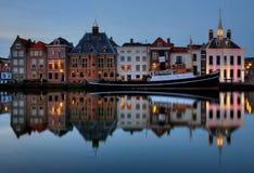 Historical townscape Maassluis. Nightfall over the historical town Maassluis in Holland, with typical dutch gabled buildings stock photography