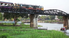 Historical train at bridge over kwai river death railway. Day time stock footage