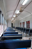 Historical Train Interior. Empty train interior, vertical view with blue seats, fans and lights Royalty Free Stock Images