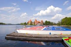Historical Trakai castle and boats on the lake Stock Photo