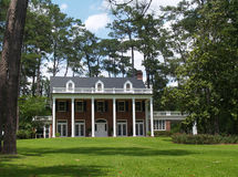 Historical Two Story Southern Residential Home. Two story residential, historical, south GA home with brick facade and white columns Stock Image