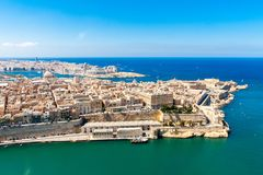 Historical Valetta, capital city of Malta, Grand harbour, Sliema town, Marsamxett bay from above. Skyscraper in Paceville district. Is in the background. Malta royalty free stock photography