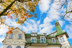 Historical villa in Swinoujscie, Poland. Historical villa and autumnal trees in Swinoujscie, Poland Stock Images