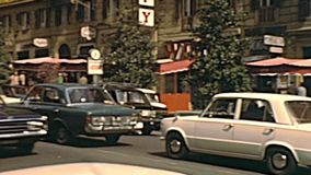 Historical Vittorio Veneto street of Rome. ROME, ITALY - CIRCA 1970: The Italian cars in traffic of famous Vittorio Veneto street, a historical luxury road of stock footage