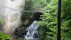 Historical watermill ruins and little waterfall stock video