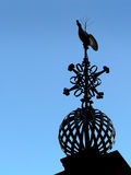 Historical Weather Vane. A rooster weather vane silhouette against a clear blue sky. It's sitting on the Portuguese church in Malacca, Malaysia Stock Photo