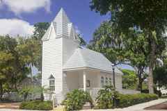 Historical white church. Historical white renovated church in Southwest Florida with tiled roof and steeple Royalty Free Stock Image