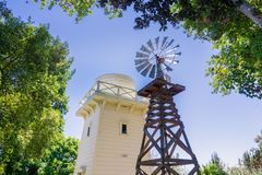 Historical wind turbine and wooden water tower Royalty Free Stock Photos