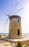 Historical windmil in Rhodes harbor Stock Images