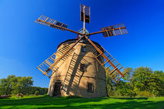 Free Historical Windmill Svetlik Near Town Krasna Lipa, Czech Republic. Beautiful Landscape With Windmill And Dark Blue Sky. Green Tree Stock Images - 91579814