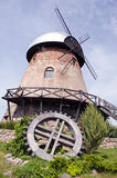 Historical windmill and wooden wheel Stock Photos