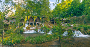 Historical wooden watermills on the Pliva lakes around Jajce with beautiful nature around it Stock Images