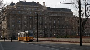 Historical yellow tram. Typical historical yellow tram passing Kossuth Lajos Square in Budapest Stock Photo