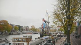Historically authentic frigate moored on the canal in Amsterdam, Holland, Netherlands, slow-motion stock footage