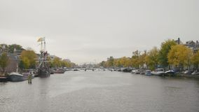 Historically authentic frigate moored on the canal in Amsterdam, Holland, Netherlands stock video