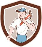 Historieta de Holding Hammer Shield del carpintero del constructor Fotos de archivo libres de regalías