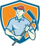 Historieta de Holding Pickaxe Shield del trabajador de construcción stock de ilustración