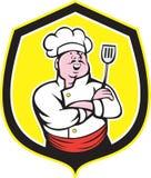 Historieta de Holding Spatula Shield del cocinero del cocinero stock de ilustración