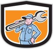 Historieta de Holding Wrench Shield del fontanero stock de ilustración