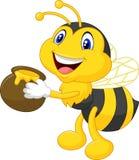 Historieta de la abeja que sostiene el cubo de la miel Imágenes de archivo libres de regalías