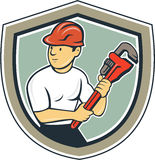 Historieta del escudo de Holding Monkey Wrench del fontanero stock de ilustración