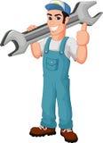 Historieta divertida del mecánico que sostiene la llave y que da los pulgares para arriba Imagenes de archivo