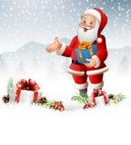 Historieta Santa Claus que sostiene una caja de regalo Fotografía de archivo libre de regalías