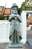 Historische chinesische Steinskulptur, Dekoration der alten chinesischen Steinpuppe im Freien, Statue der chinesischen Kriegerssk Stockfotografie