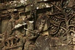 Historischer Bas Relief, der alte Khmerkrieger in der Bildung darstellt und Kampf, Siem Reap tut Lizenzfreies Stockbild