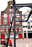 Historisches Haus mit alter gehender Brücke Lizenzfreies Stockfoto