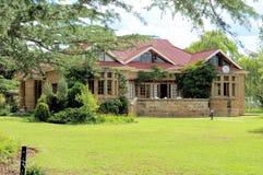 Historisches Sandsteinpfarrhaus, Clarens, Südafrika Lizenzfreies Stockfoto