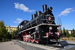 Historisk ångalokomotiv på skärm i Astana Arkivfoton