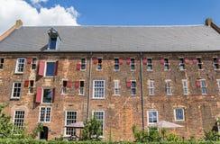 Historisk byggnad Arsenaal i mitten av Doesburg Royaltyfria Bilder